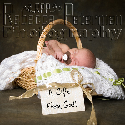 Baby in basket with A Gift from God tag