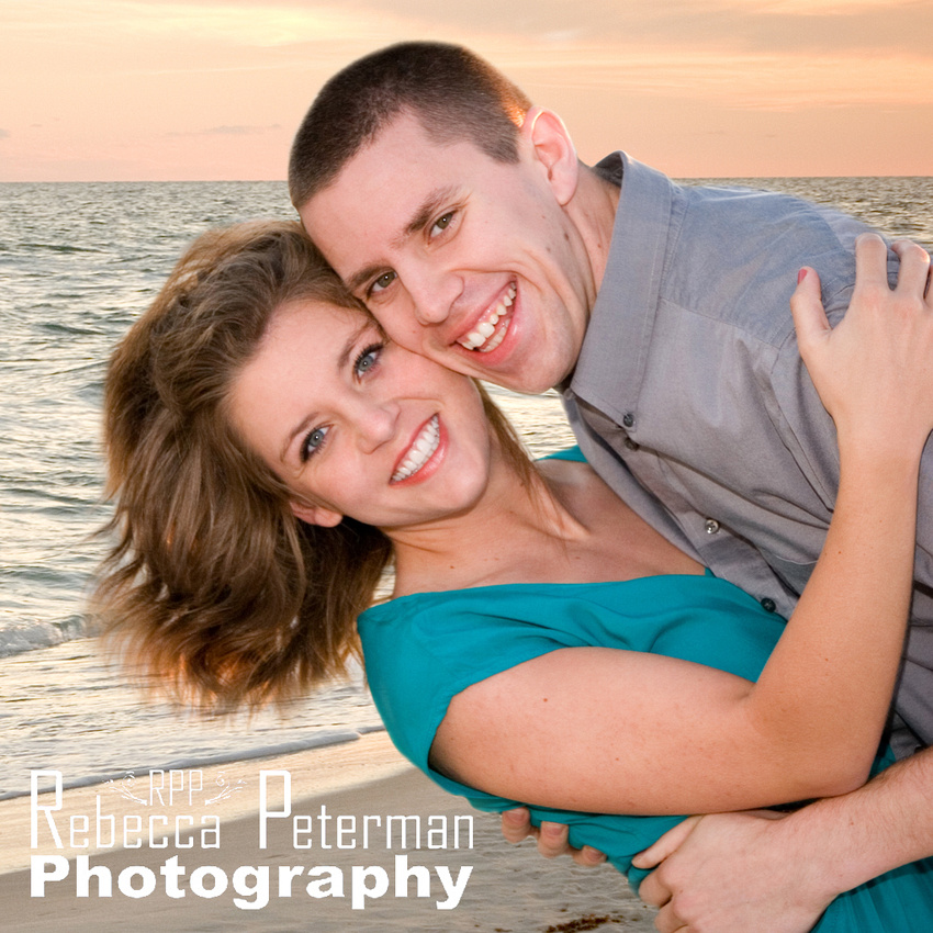 smiling couple on beach at sunset
