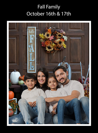 Father, mother, and two children on fall background in studio