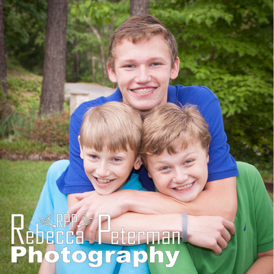 Teen boy with two little brothers