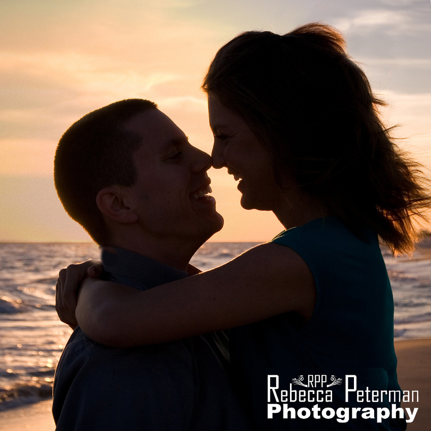 Couple silhouette on beach at sunset